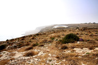 A distant view of one of the protective 'tents' at Mnajdra.