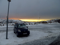 Late afternoon and a  snowy airport carpark.